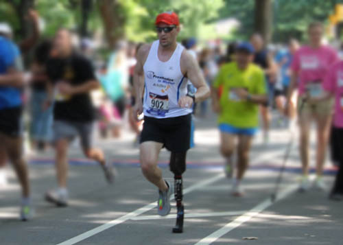 An Above the Knee Amputee runs at the Achilles International Hope and Possibilities Run